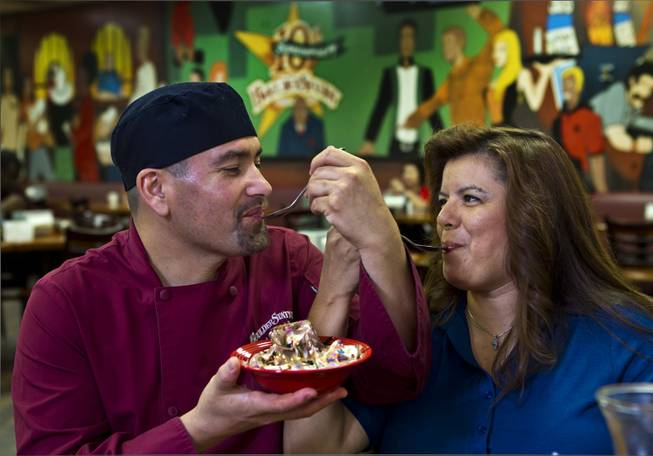 Boulder Station feast cook Jorge Parra and his wife Cecilia Parra share a sundae in the Grand Cafe on Friday, August 15, 2014.  They met there when she was a cafe hostess and are pleased to be helping the casino in celebrating its 20th year anniversary.