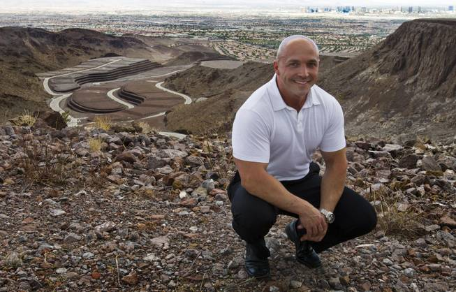Ascaya Sales Manager Darin Marques atop the mountain-mansion development,  reservations now being accepted to begin the purchasing process in Henderson on Wednesday, August 20, 2014.