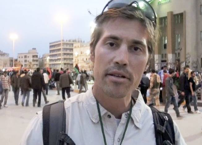 This undated file still image from video released April 7, 2011, by GlobalPost, shows James Foley of Rochester, N.H., a freelance contributor for GlobalPost, in Benghazi, Libya. In a horrifying act of revenge for U.S. airstrikes in northern Iraq, militants with the Islamic State extremist group have beheaded Foley — and are threatening to kill another hostage, U.S. officials say.