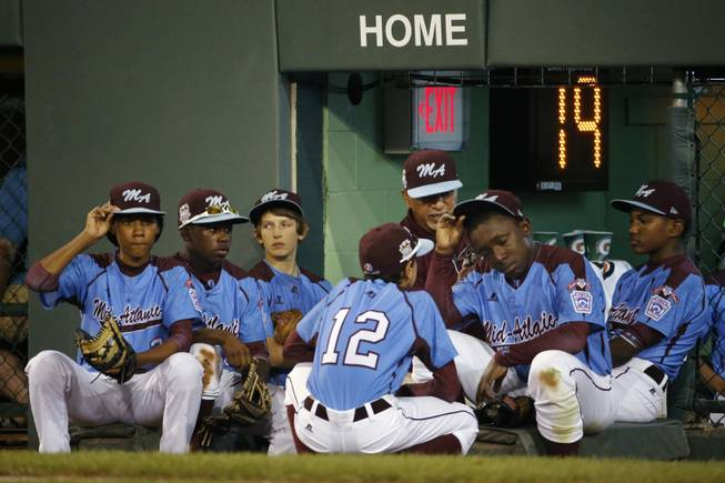 Philadelphia players wait on the dugout steps to the take the field for the sixth inning of a United States semi-final baseball game against Las Vegas at the Little League World Series tournament in South Williamsport, Pa., Wednesday, Aug. 20, 2014. Las Vegas won 8-1. (AP Photo/Gene J. Puskar)
