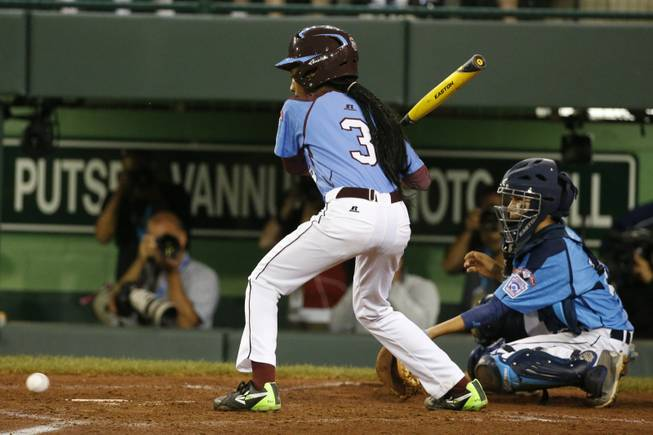Philadelphia's Mo'ne Davis watches as a 3-2 pitch by Las Vegas pitcher Brad Stone bounces past the catcher allowing Davis to get on base and Philadelphia's only run of the game to score in the fourth inning of a United States semi-final baseball game at the Little League World Series tournament in South Williamsport, Pa., Wednesday, Aug. 20, 2014. Las Vegas won 8-1. (AP Photo/Gene J. Puskar)