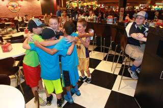 Mountain Ridge Little League teammates cheer at the Red Rock Resort after their older teammates won to advance to the finals of the Little League World Series Wednesday, Aug. 20, 2014.