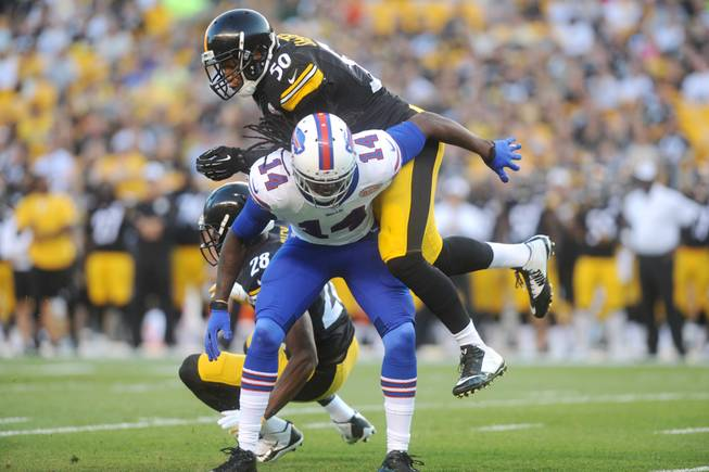 Pittsburgh Steelers outside linebacker Ryan Shazier (50) hits Buffalo Bills wide receiver Sammy Watkins (14) in the first quarter of the NFL football preseason game on Saturday, Aug. 16, 2014 in Pittsburgh.