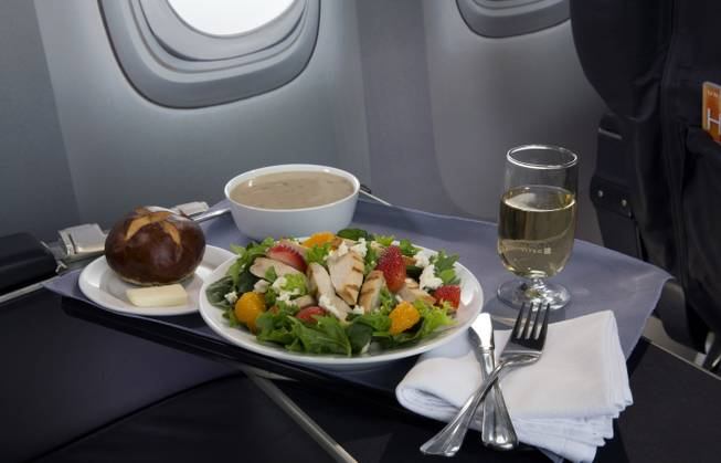This product image provided by United Airlines shows a Strawberry Fields Salad, one of a variety of the airline's new first class food options. The Chicago-based airline on Thursday, Aug. 21, 2014, announced that it's upgrading first-class food options and replacing snacks with full meals on some of its shortest flights.
