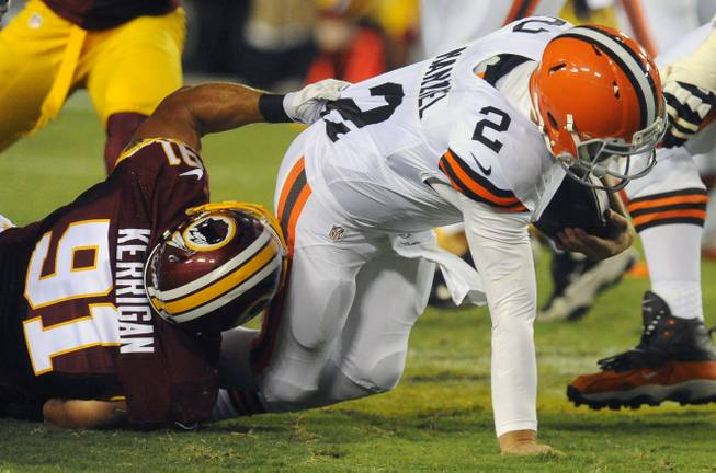 Washington Redskins outside linebacker Ryan Kerrigan (91) sacks Cleveland Browns quarterback Johnny Manziel (2) during the first half of an NFL preseason football game Monday, Aug. 18, 2014, in Landover, Md.