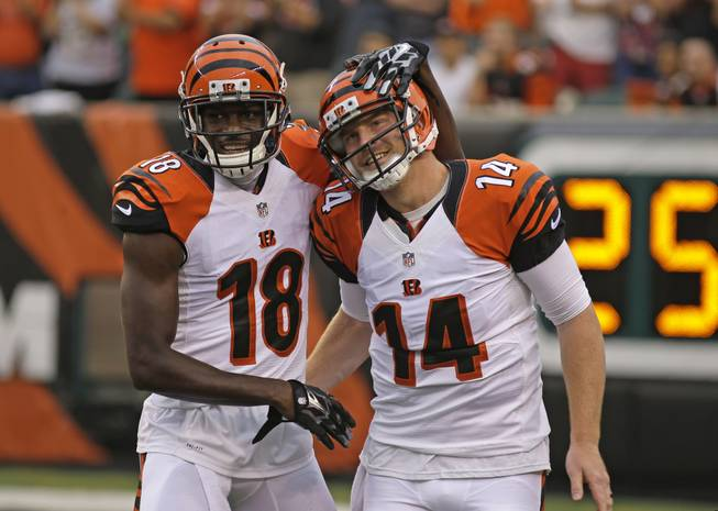 Cincinnati Bengals wide receiver A.J. Green (18) and quarterback Andy Dalton (14) celebrate after the Bengals scored against the New York Jets in the first half of an NFL preseason football game, Saturday, Aug. 16, 2014, in Cincinnati.