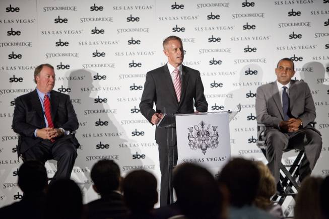 Rob Oseland, center, president of SLS Las Vegas, speaks during a press conference with Terry Fancher, left, executive managing director at Stockbridge, and Sam Nazarian, CEO at SBE Entertainment, at SLS Las Vegas on Friday, Aug. 22, 2014.
