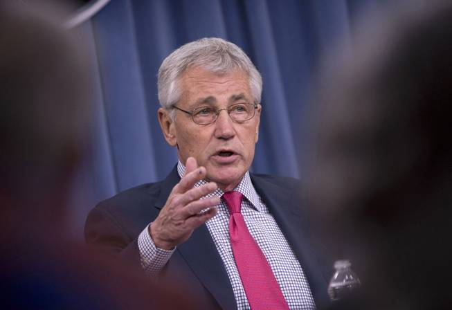 This July 3, 2014 file photo shows Defense Secretary Chuck Hagel speaking at the Pentagon. Hagel said Thursday that US airstrikes have helped Iraqi and Kurdish forces regain their footing in Iraq, but he expects Islamic State militants will regroup and stage a new offensive.