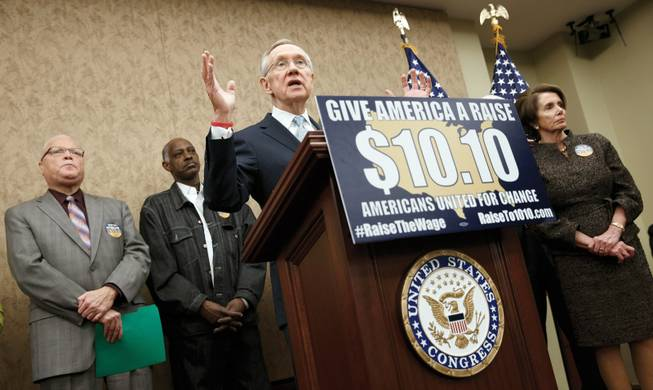 Senate Majority Leader Harry Reid, D-Nev., speaks during an April event to urge raising the minimum wage. Featured on the lectern are both a Twitter hashtag and website. The hashtag has become ubiquitous in American politics since the advent of Twitter.