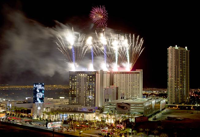 Fireworks explode during the grand opening of SLS Las Vegas, formerly the Sahara, in the early hours of Saturday, Aug. 23, 2014. The property, owned by SBE Entertainment and Stockbridge Real Estate, reopened after a $415 million renovation.
