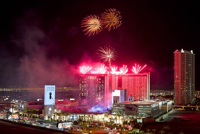 Fireworks explode during the grand opening of SLS Las Vegas, formerly the Sahara, in the early hours of Saturday, Aug. 23, 2014.