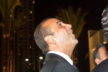 Sam Nazarian, founder, chairman and CEO of SBE, watches the fireworks display above SLS Las Vegas during the grand-opening celebration Saturday, Aug. 23, 2014, on the Strip.