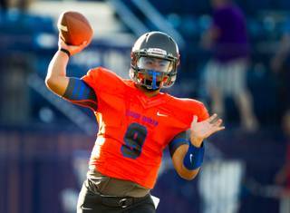 Bishop Gorman QB Danny Hong #9 fires a pass downfield during their game against Brophy Prep on Friday, August 22, 2014.