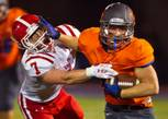 Bishop Gorman RB Jonathan Shumaker (#33) breaks free for another touchdown run with a stiff arm to the helmet of Brophy Prep LB Cole Wiegand (#7) on Friday, Aug. 22, 2014.