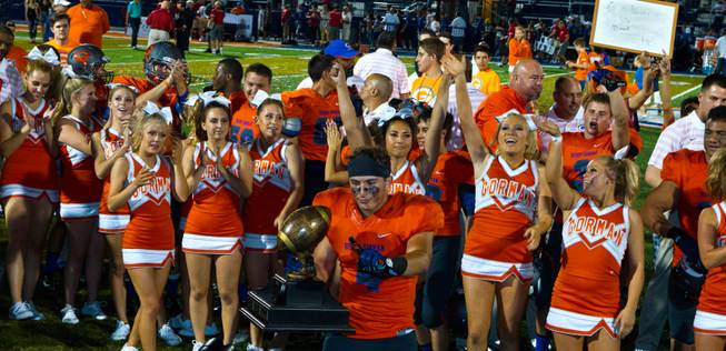 Bishop Gorman players, coaches and cheerleaders celebrate their Sollengber Classic win versus Brophy Prep with a score of 44-0 on Friday, August 22, 2014.