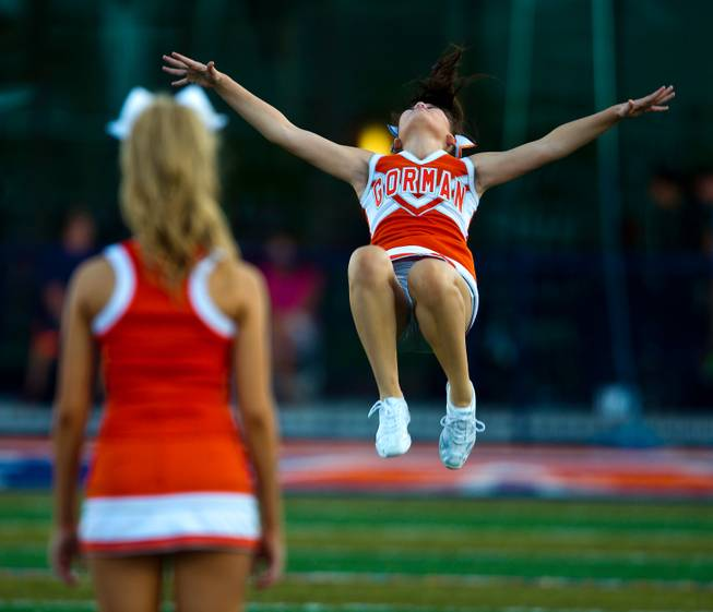 A Bishop Gorman cheerleader flips for the crowd before the start of the game against Brophy Prep on Friday, August 22, 2014.