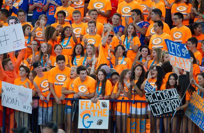 Bishop Gorman fans have signs at the ready as they prepare to battle against Brophy Prep on Friday, August 22, 2014.