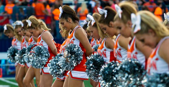 Bishop Gorman cheerleaders perform for the crowd before the start of the game against Brophy Prep on Friday, August 22, 2014.