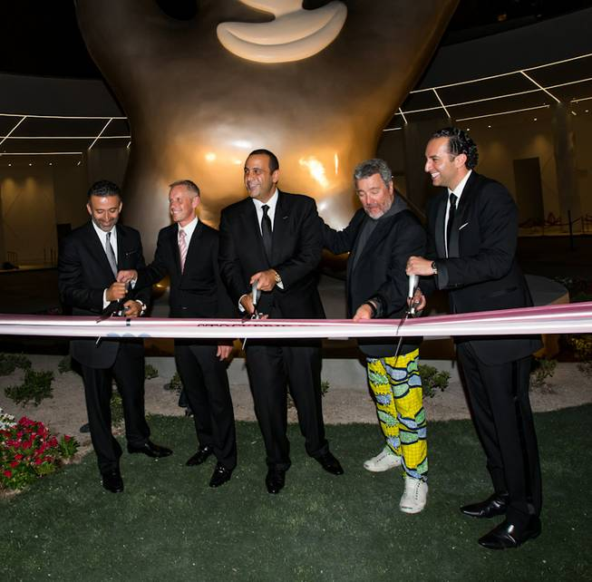 Arash Azarbarzin, president, SBE Hotel Group; Rob Oseland, president and COO, SLS Las Vegas; Sam Nazarian, founder, chairman and CEO, SBE; designer Philippe Starck; and Sam Bakhshandehpour, president, SBE, at the grand opening of SLS Las Vegas on Friday, Aug. 22, 2014, on the Strip.