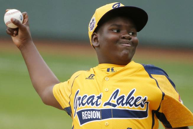 Chicago's Joshua Houston delivers in the first inning of a United States Championship game against Las Vegas at the Little League World Series tournament in South Williamsport, Pa., Saturday, Aug. 23, 2014. (AP Photo/Gene J. Puskar)