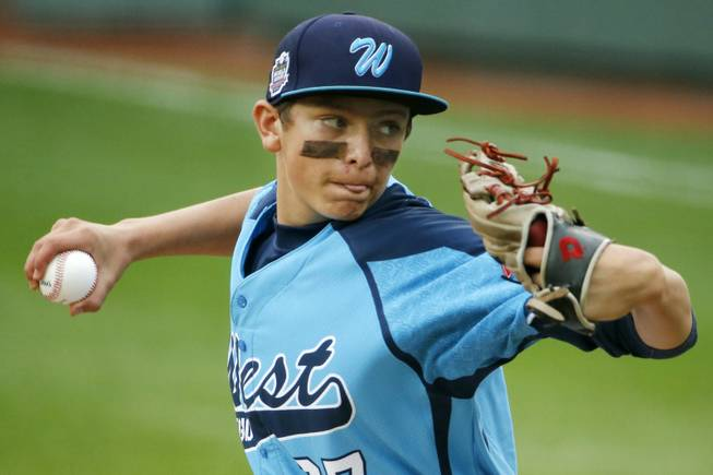 Las Vegas' Brennan Holligan (27) delivers in the first inning of the United States Championship game against Chicago  at the Little League World Series tournament in South Williamsport, Pa., Saturday, Aug. 23, 2014. (AP Photo/Gene J. Puskar