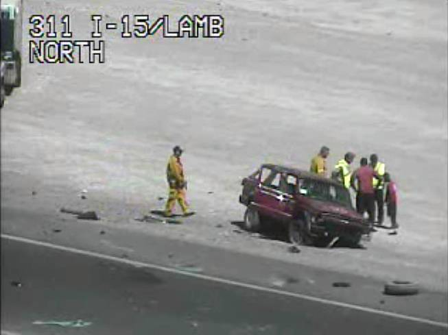 A screen grab of a Nevada Transportation Department traffic camera shows a Jeep Cherokee on the shoulder of northbound Interstate 15.