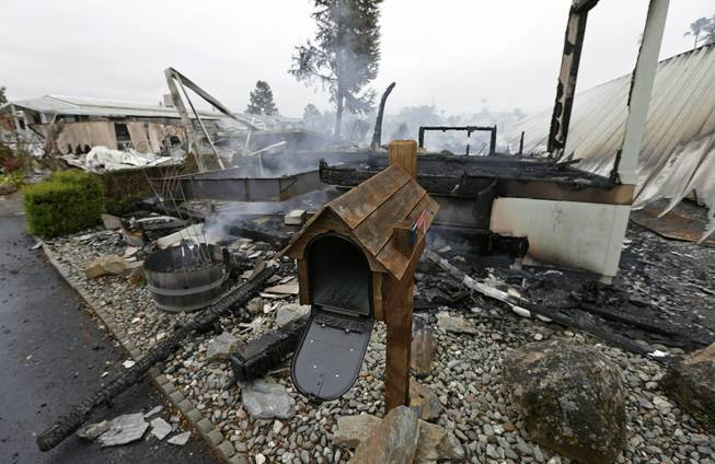 A mailbox is all that remains of one of four mobile homes which were destroyed in a gas fire Sunday, Aug. 24, 2014, at the Napa Valley Mobile Home Park, in Napa, Calif. A large earthquake caused significant damage and left at least three critically injured in California's northern Bay Area early Sunday, igniting fires, sending at least 87 people to a hospital, knocking out power to tens of thousands and sending residents running out of their homes in the darkness.