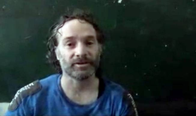 In this image made from undated video obtained by The Associated Press, which has been authenticated based on its contents and other AP reporting, a man believed to be Peter Theo Curtis, a U.S. citizen held hostage by an al-Qaida linked group in Syria, delivers a statement. The U.S. government said on Sunday, Aug. 24, 2014 that Curtis, who had been held hostage for about two years, had been released.