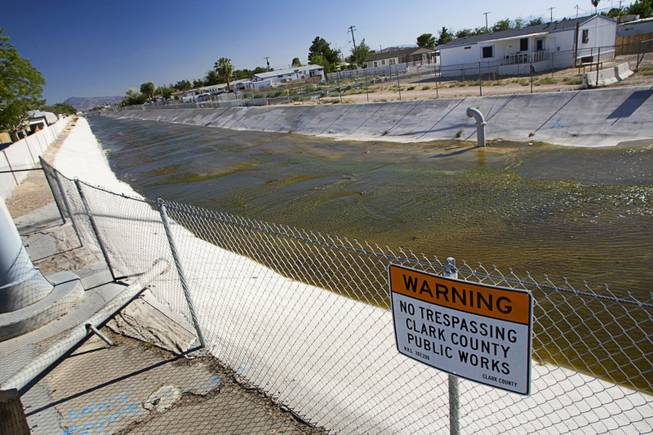 Treated wastewater from the new City of North Las Vegas Water Reclamation Facility flows down the Sloan channel near Toiyabe Street and East Carey Avenue on Thursday, June 23, 2011, in Las Vegas.