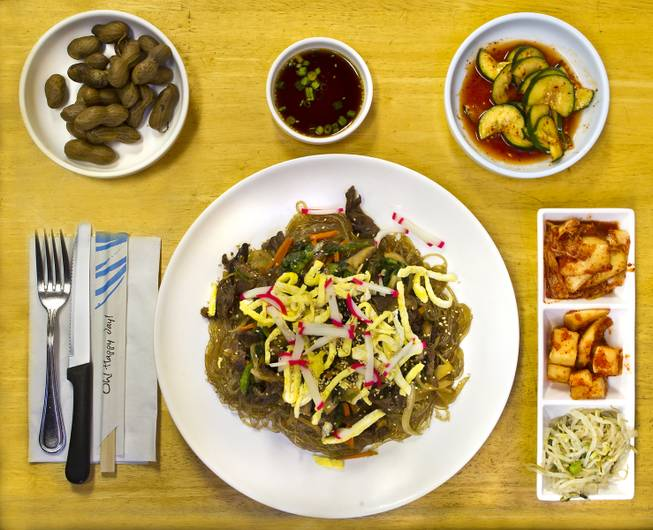 Island Style features the dish Japchae on Thursday, August 21, 2014.  (Upper left) It is joined by appetizers boiled peanuts, cucumbers, cabbage, radishes and bean sprouts.