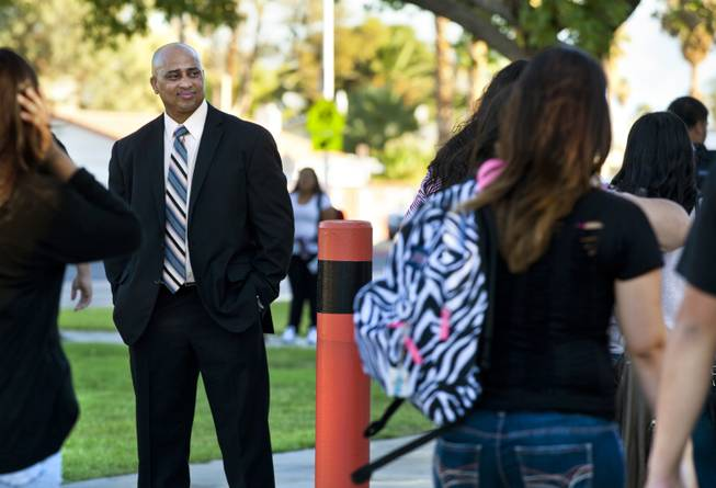 Chaparral High School Principal Lolo James watches students stream by as he begins his first day as the top administrator there, Aug. 25, 2014. A new master's program in educational leadership will train and prepare principals for the challenges they'll face in Las Vegas today.