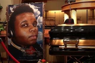 The casket of Michael Brown sits inside Friendly Temple Missionary Baptist Church awaiting the start of his funeral on Monday, Aug. 25, 2014. Brown, who is black, was unarmed when he was shot Aug. 9 in Ferguson, Mo., by Officer Darren Wilson, who is white.