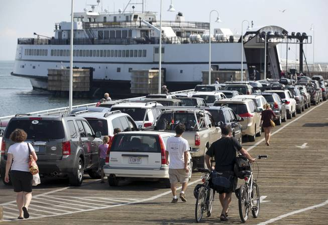 In this Aug. 26, 2011, file photo, passengers with cars and bicycles prepare to board a ferry departing the island of Martha's Vineyard, in Oak Bluffs, Mass. Leaders of the Aquinnah Wampanoag tribe propose to convert an unfinished community center on the island into a high-stakes bingo and poker hall, hoping to tap into the influx of tourist dollars each summer.