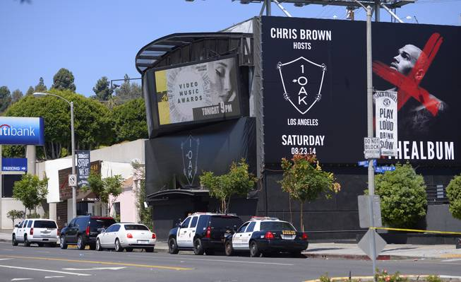 "Sheriffs are seen outside the 1OAK club, Sunday, Aug. 24, 2014, in West Hollywood, Calif. Death Row Records founder and rap mogul Marion ""Suge"" Knight was injured in an early morning shooting Sunday in the packed nightclub but was expected to survive, a Los Angeles County sheriff's sergeant said."