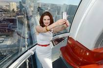 Holly Madison rides the High Roller on Sunday, Aug. 24, 2014, at the Linq Promenade.
