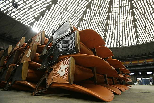 Old Astrodome seats sit in stacks around the unused historic domed stadium Tuesday, Aug. 26, 2014, in Houston. County officials are proposing turning the stadium into the world's largest indoor park.