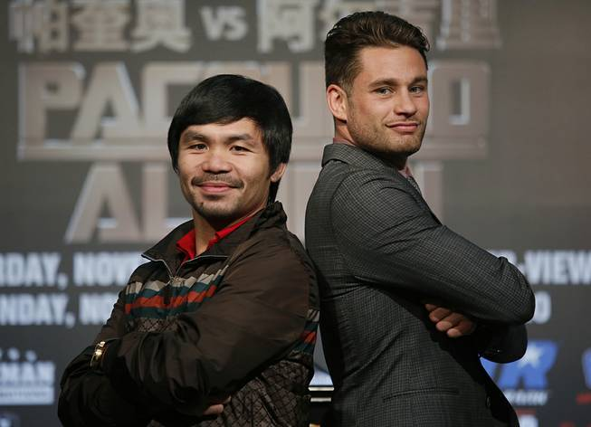 WBO Welterweight champion Manny Pacquiao, left, of the Philippines, and WBO junior welterweight champion Chris Algieri of United States, right, pose for photographers during a news conference in Macau, Monday, Aug. 25, 2014. The boxers are scheduled to battle in WBO welterweight title match at The Venetian Macao on Nov. 23 in Macau.
