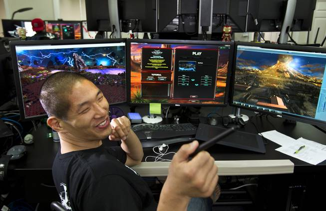 "Four Lights 3D Modeler Andrew Wong is with the self-producing and self-publishing video game company on Wednesday, August 27, 2014. Their first release is multiplayer tower defense game ""Defenders of Time,"" slated for official release in September. L.E. Baskow"
