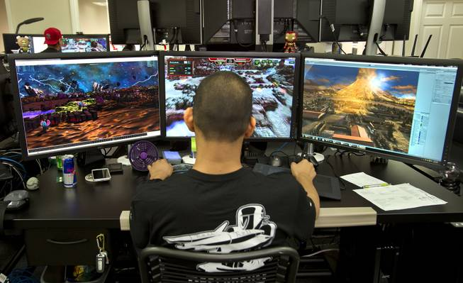 "Four Lights 3D Modeler Andrew Wong is with the self-producing and self-publishing video game company on Wednesday, August 27, 2014. He plays their first release  multiplayer tower defense game ""Defenders of Time,"" slated for official release in September. L.E. Baskow"