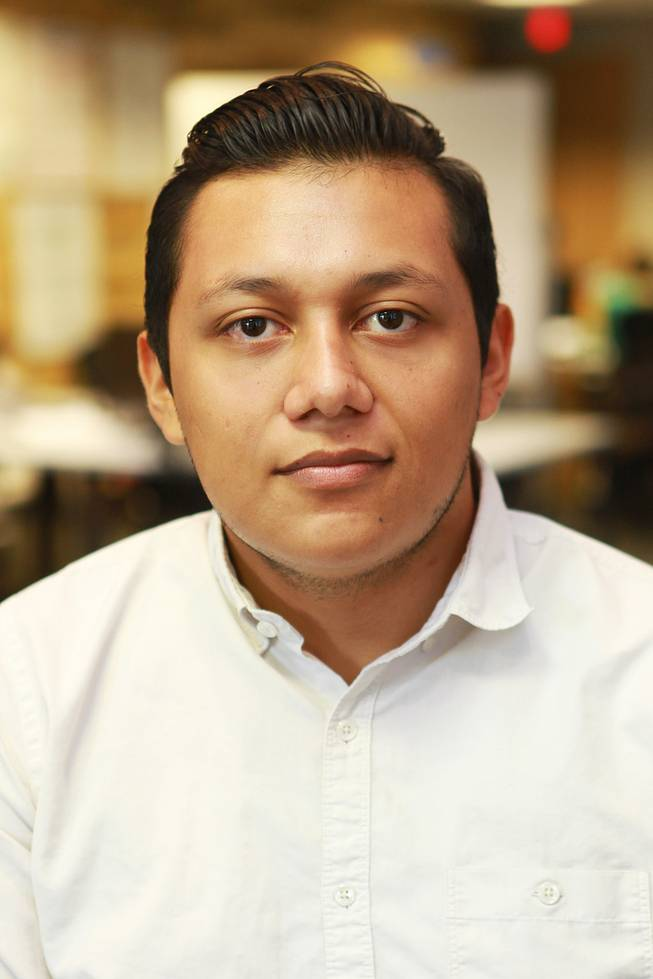 "Marcos Ontiveros worked to create the anti-bullying app ""Bully Alert,"" and is seen in his new workspace Wednesday, Aug. 27, 2014."
