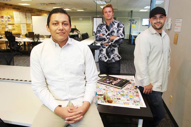 "Marcos Ontiveros, Blaze Brooks and Evan Savar, who have collaborated to create the anti-bullying app ""Bully Alert,"" are seen in their new workspace Wednesday, Aug. 27, 2014."
