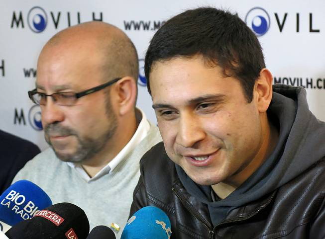 Mauricio Ruiz, 24, sailor of the Chilean Navy, right, comes out publicly as gay during a press conference in Santiago, Chile, Wednesday Aug. 27, 2014. Ruiz who was accompanied by Rolando Jimenez, left, president of the Homosexual Liberation and Integration Movement, is the first member of the Chilean armed forces ever to come out publicly as gay with the approval of the High Command of the Chilean navy.