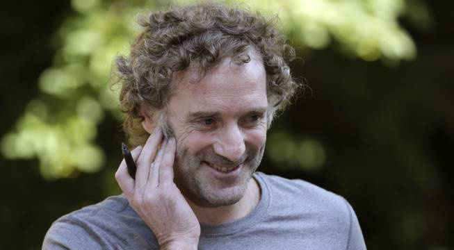 Peter Theo Curtis smiles as he talks with reporters outside his mother's home in Cambridge, Mass., Wednesday, Aug. 27, 2014. Curtis, a freelance reporter who wrote under the byline Theo Padnos and who had been held hostage for about two years in Syria, returned to the U.S. Tuesday.