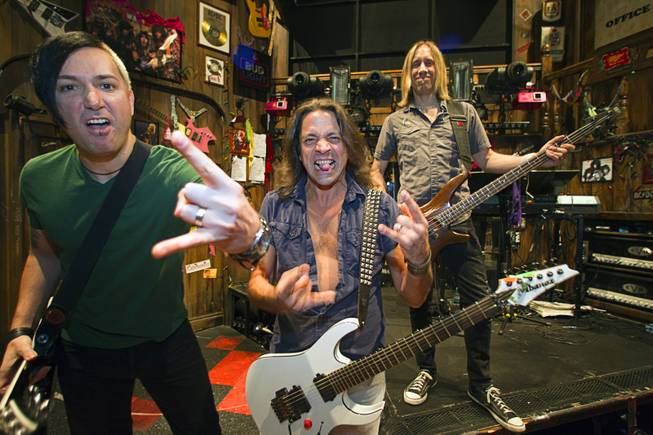 "Guitarist Andy Gerold, left, guitarist Chris Cicchino, center, and bassist Dan Grennes strike a pose on stage before a performance of ""Rock Of Ages"" at the Venetian Wednesday, Aug. 27, 2014."