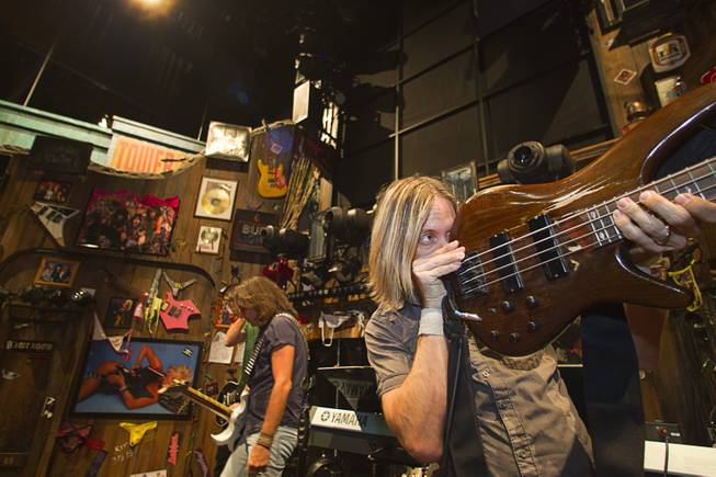 "Guitarists and bassist Dan Grennes, right, prepare for a performance of ""Rock Of Ages"" at the Venetian Wednesday, Aug. 27, 2014."