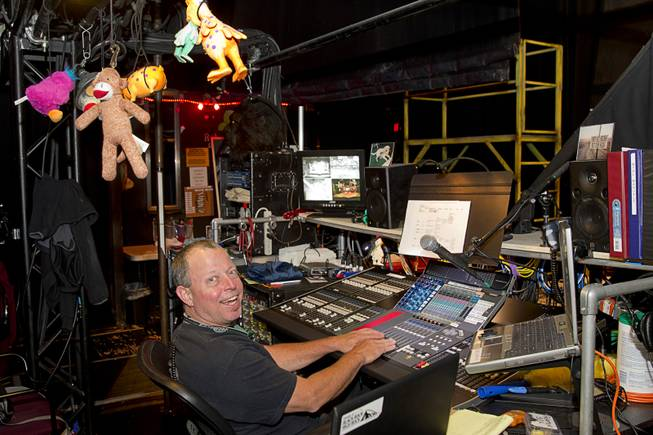 "Cameron Grant, monitor engineer, is shown at his station before a performance of ""Rock Of Ages"" at the Venetian Wednesday, Aug. 27, 2014."