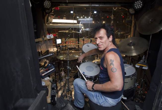 "Drummer Alan Childs poses before a performance of ""Rock Of Ages"" at the Venetian Wednesday, Aug. 27, 2014."
