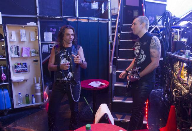 "Guitarists Chris Cucchino, left, and Andy Gerold wait backstage before a performance of ""Rock Of Ages"" at the Venetian Wednesday, Aug. 27, 2014."
