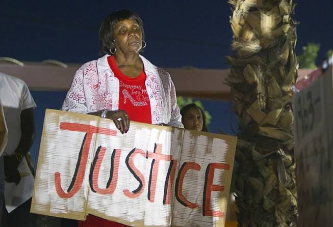 Patricia Polk participates in a vigil for Michael Brown at Martin Luther King Boulevard and Carey Avenue Thursday, August 28, 2014. Brown, 18, was shot and killed by a police officer Aug. 9, 2014 in Ferguson, Mo.