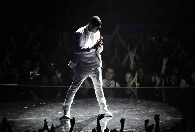 AP10ThingsToSee- Usher performs at the MTV Video Music Awards at The Forum on Sunday, Aug. 24, 2014, in Inglewood, Calif. (Photo by Chris Pizzello/Invision/AP)